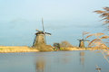 Windmills with reflection in the water windmill landscape winter at kinderdijk netherlands beautiful Royalty Free Stock Photography