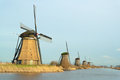 Windmills in a row windmill landscape the winter at kinderdijk the netherlands Royalty Free Stock Image