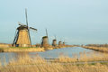 Windmills in a row windmill landscape the winter at kinderdijk the netherlands Royalty Free Stock Photo