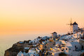Windmills of santorini dramatic sunset over the oia village island greece Royalty Free Stock Photos