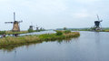 Windmills and waters of kinderdijk one the most visited touristic attractions in the netherlands Royalty Free Stock Images