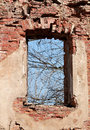 Window aperture bare of a ruined house Royalty Free Stock Photos