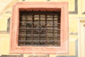 Window with bars renaissance in the wall paintings of bricks Royalty Free Stock Photo