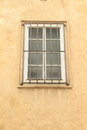 Window with bars white iron in yellow wall Royalty Free Stock Photography
