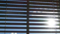 Window blinds wooden with sun and blue sky in the background Royalty Free Stock Photos