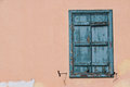 Window with blue shutter Royalty Free Stock Photo