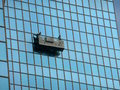 Window cleaning suspended platform or cradle for windows of a skyscraper Stock Photos