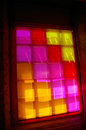 Window with colored glass in a brick wall of an old industry Stock Photography
