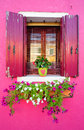Window of a crimson house Stock Photo