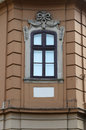 Window decor of the facade of the building in cultural traditions windows are framed with elegant stucco Royalty Free Stock Photo