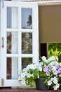 Window decorated with fresh flowers Stock Photos