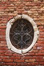 Window with decorative bars old on a red brick Stock Photography