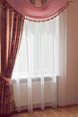 Window design pink curtains with drapes and fringe Stock Image