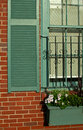 Window detail in old brick house with flowers Royalty Free Stock Image
