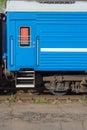 Window and door of the blue locomotive wagon.