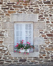 Window with flower decoration old antique in france Royalty Free Stock Image
