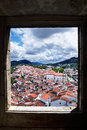 Window framed overview of castelo de vide the historic part town through an old stone alentejo portugal Stock Photo