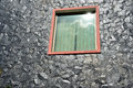 The window with glass on a rock wall Royalty Free Stock Images