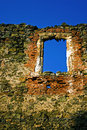 Window in history late gothic framing of the north palace from soimos castle situated on a hill nearby the european road e after Stock Photography