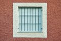 Window with iron bars and shutters closed Royalty Free Stock Images
