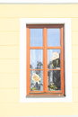 Window with kite paper in wooden in orrange house Stock Image
