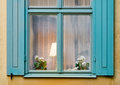 Window with lamp and flower Royalty Free Stock Photo