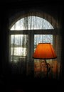 Window with lamp sun and river in the backround Stock Photography