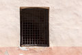 Window with lattice in old wall Royalty Free Stock Photo