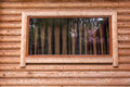 Window log house rectangular with brown curtain behind the glass cabin wall Royalty Free Stock Photo