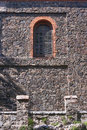 Window on medieval stone wall of the church Royalty Free Stock Photo