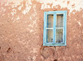Window old on a adobe wall Royalty Free Stock Photo