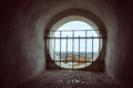 Window in the old bell tower with the lattice overlooking Royalty Free Stock Photo