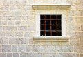 Window in old stone wall montenegro century Stock Photo