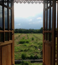 The window old thai styled though green farm view Stock Photography