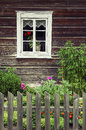 Window of an old traditional log house Royalty Free Stock Photo