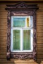 Window of old traditional russian wooden house. Stock Image