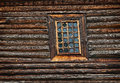 Window old wooden church built of larch wood Stock Photo
