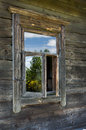 Window of old wooden house on a farm wall Stock Photography