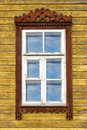 Window of old wooden house yellow painted Stock Images