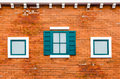 Window on the orange brick wall green outside house in italy retro style Stock Image