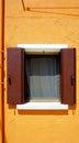 Window on orange wall in burano building architecture venice italy Stock Photos