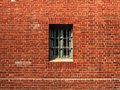 The window in a the prison wall Stock Photos