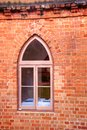 Window in a red brick wall Royalty Free Stock Photos