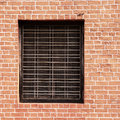 Window and red brick wall as background Stock Photography