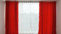 Window with red curtains open Royalty Free Stock Photo
