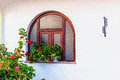 Window and red geraniums
