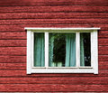 Window in a red wooden house see my other works portfolio Stock Photo