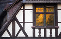 Window reflection in half timbered house colorful Royalty Free Stock Image