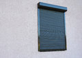Window with rolling shutter Royalty Free Stock Photo