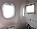 Window seat airplane with lcd screen Royalty Free Stock Photos